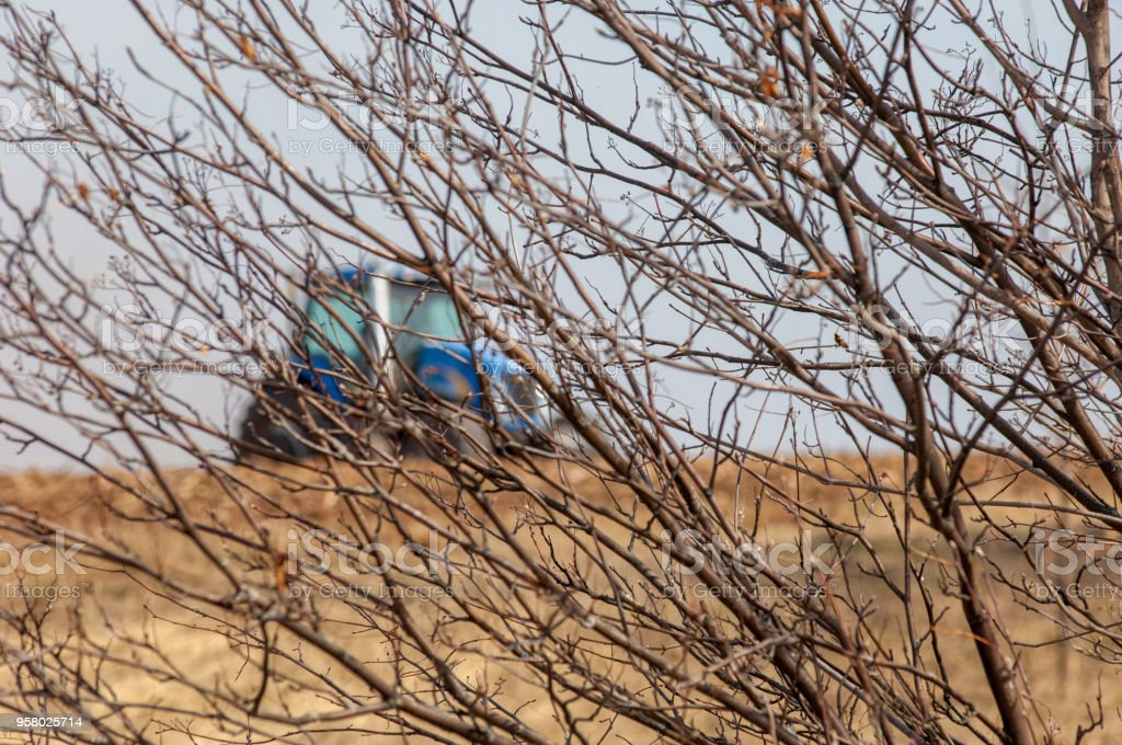 2017 05 01 Tatarstan Russia spring field works are started on time and are in accordance with the regulations. The tractor plows the field. Hilly freshly fallen fields. warm spring sun. sowing season stock photo