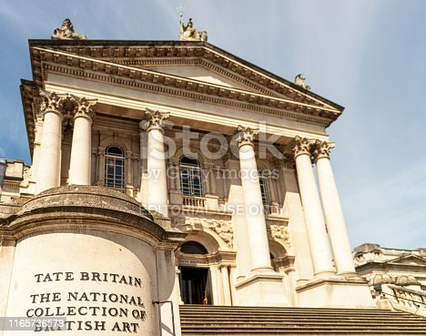 London, UK - A sign by the stairs leading up to the entrance of the Tate Britain gallery in central London.