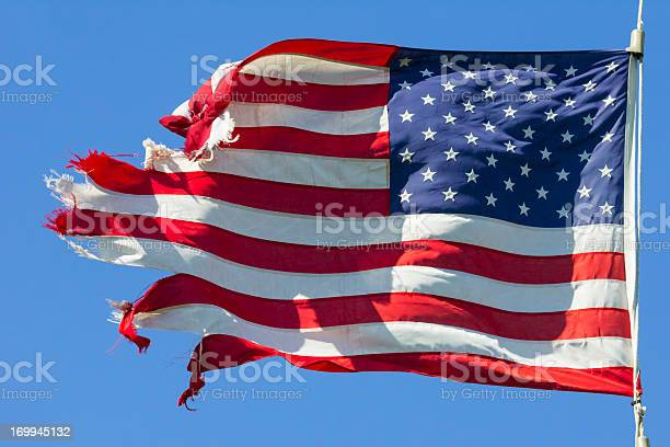 Photo of Tattered American Flag, Still Flying Free and Proud