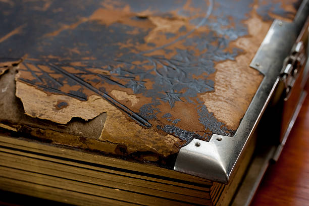 Tattered old leather album stock photo