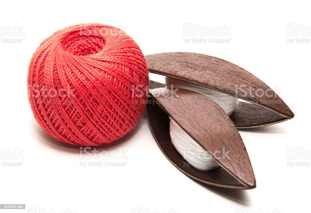 tatting shuttle thread spool pin on a white background stock photo