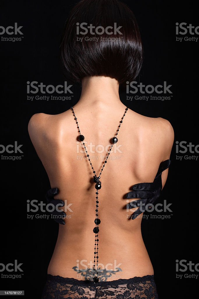 Tattoed tan model back stock photo