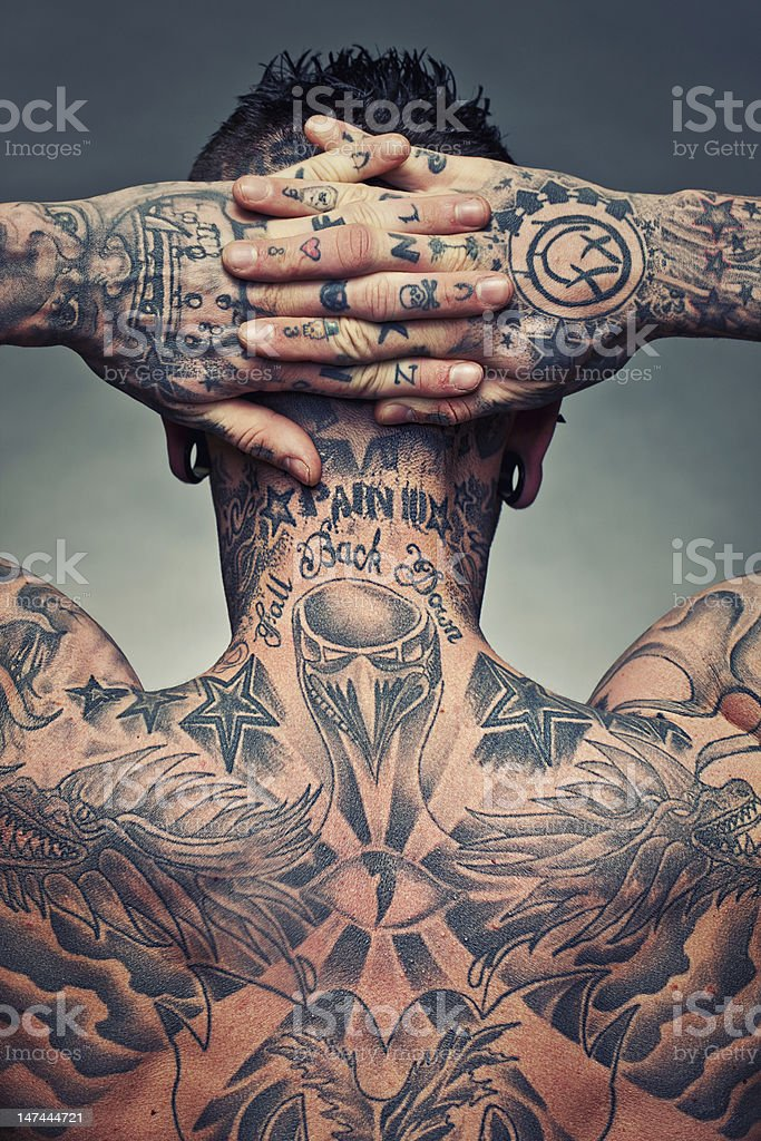 Tattoo artist back stock photo