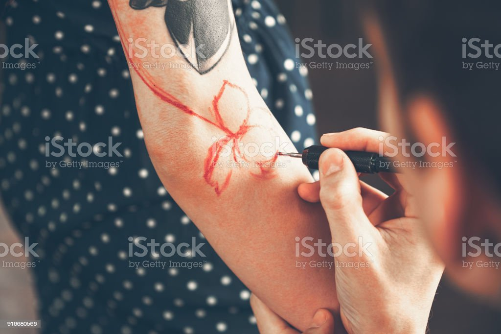 Tattoo Artist Creating A Tattoo On A Girls Arm Stock Photo & More ...