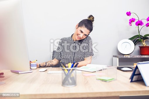 518704237 istock photo Tattoo business woman in office 668603328