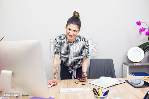 518704237 istock photo Tattoo business woman in office 668603402