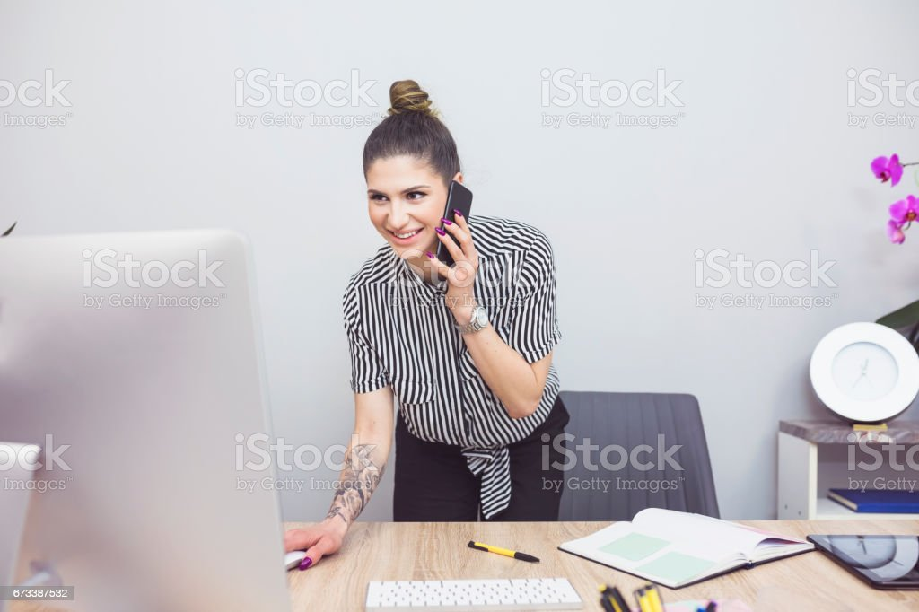 Tattoo business woman in office stock photo
