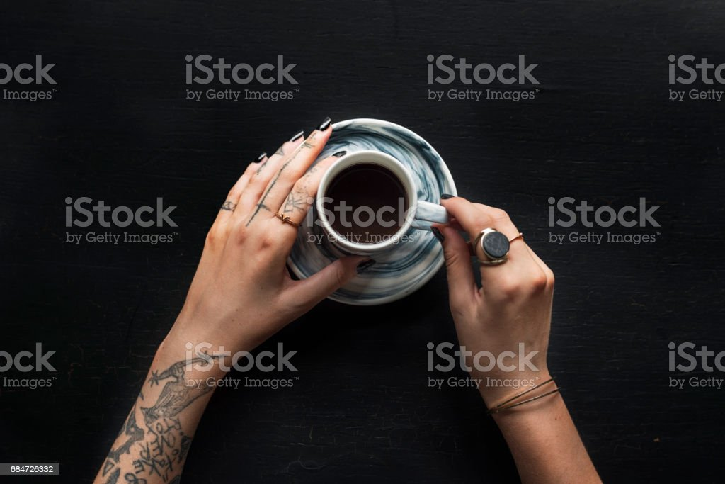 Tattoo Hands with Coffee Cup Beverage stock photo