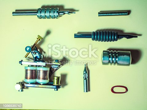 istock tattoo machine made of steel, with accessories 1056535742