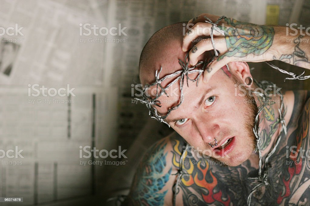 Tattoo man with rage royalty-free stock photo
