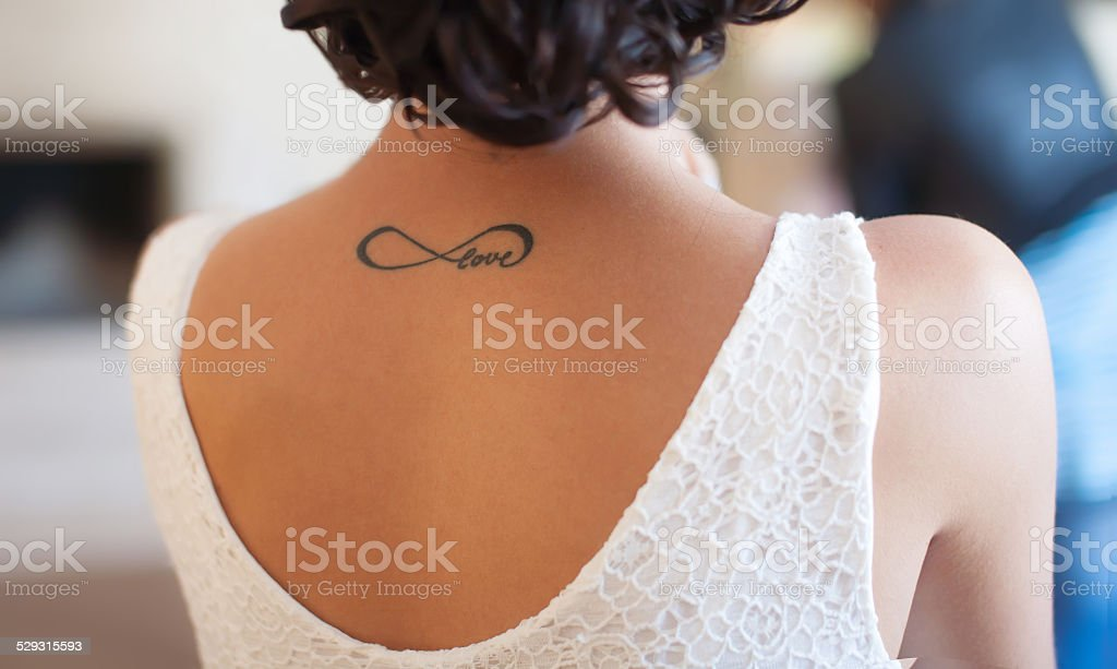 Tattoo on back girl stock photo