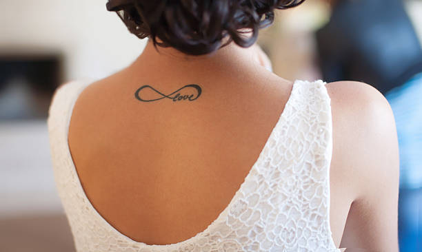 tattoo on back girl - tattoo stock photos and pictures