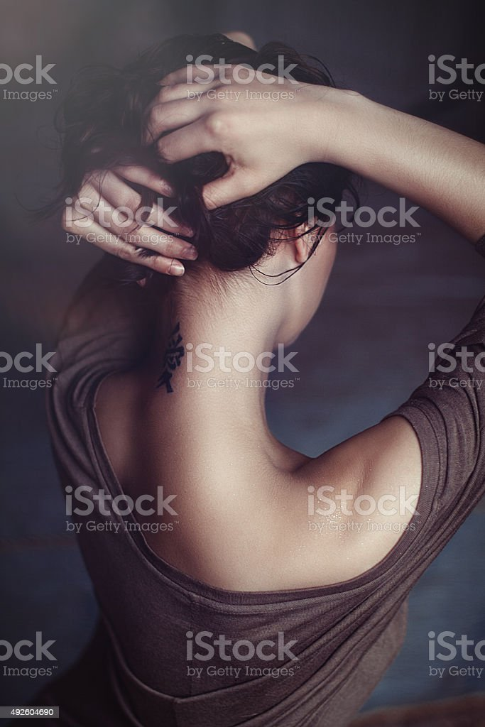 Tattoo on neck stock photo