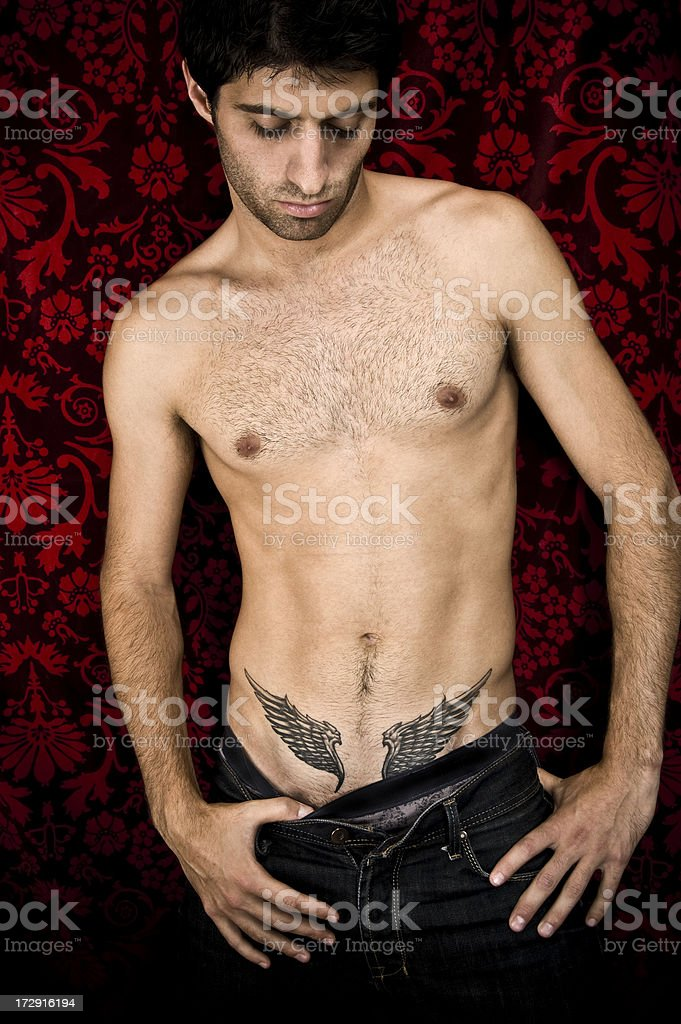 Woman With Tattoo On Shoulder Posing High-Res Stock Photo