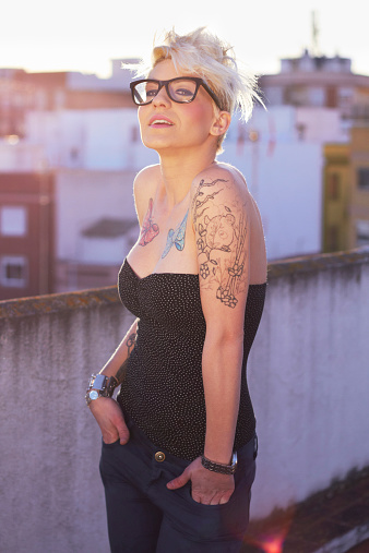 Shot of a young woman with tattoos
