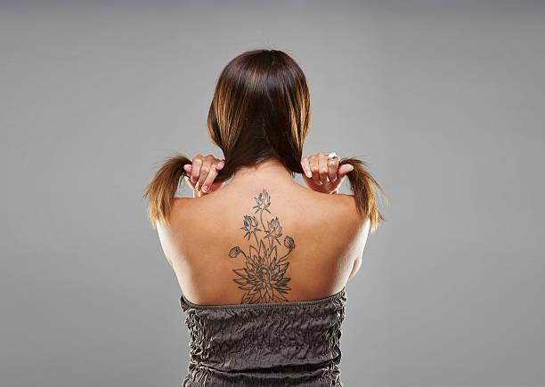 Tattoo Rücken Bilder Und Stockfotos Istock