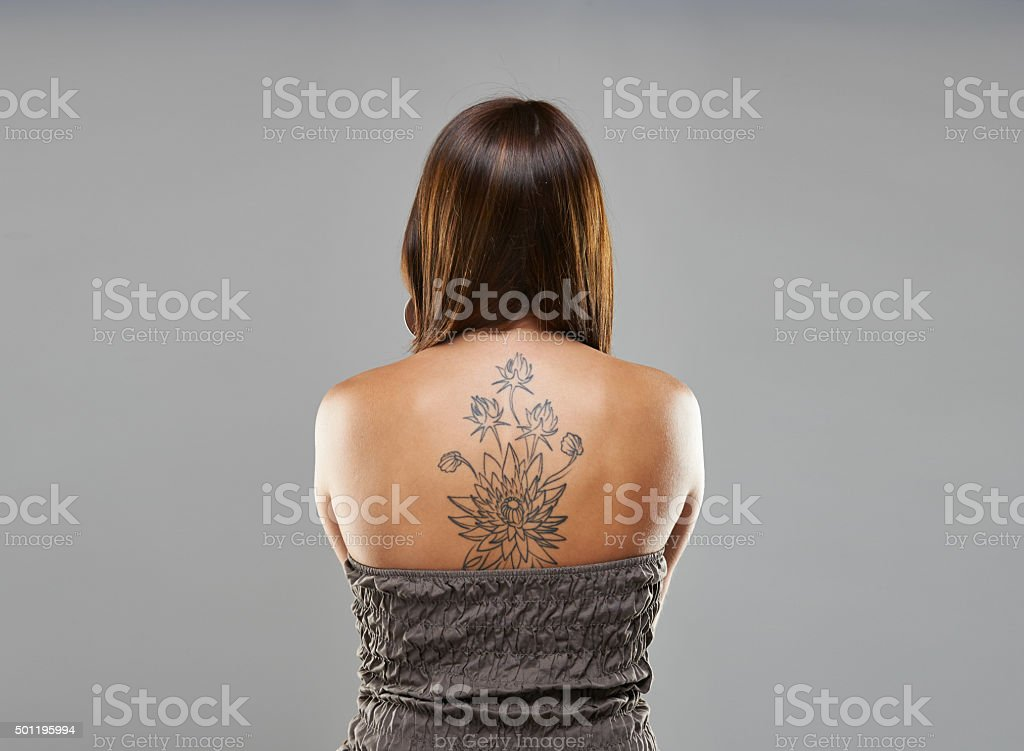 Tattoo woman portrait in studio shoot stock photo
