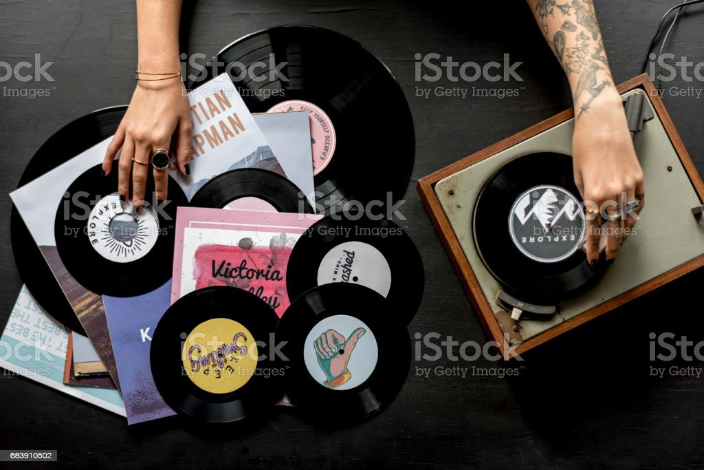 Tattoo Woman with Music Vinyl Record Disc with Player stock photo