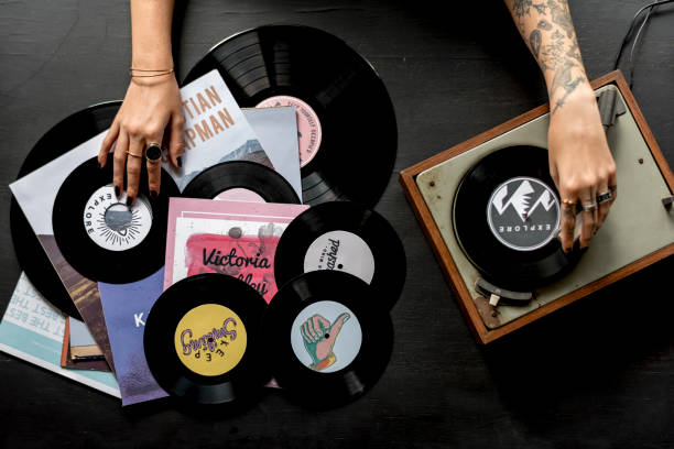 tattoo woman with music vinyl record disc with player - records stock photos and pictures