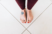 Overhead view of tattooed female foot