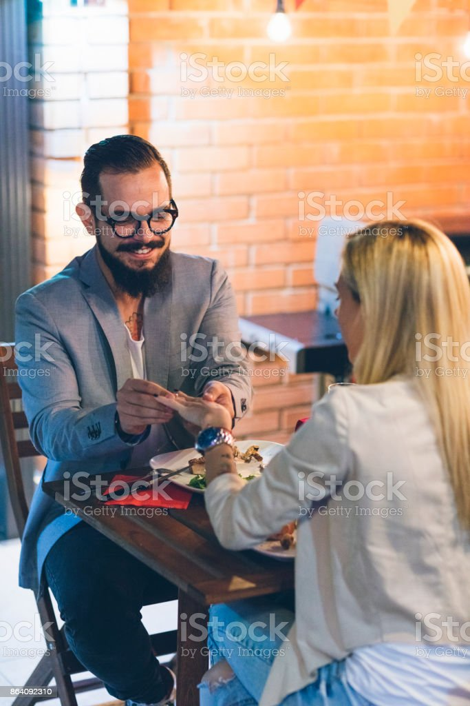 Tattooed Couple Having Romantic Backyard Barbecue Dinner With Proposal royalty-free stock photo