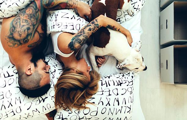 Tattooed couple with their dog sleeping picture id510614082?b=1&k=6&m=510614082&s=612x612&w=0&h=f0bx3cobsr38n4zcf6kpvrsem8gi0zj4yykep26tono=