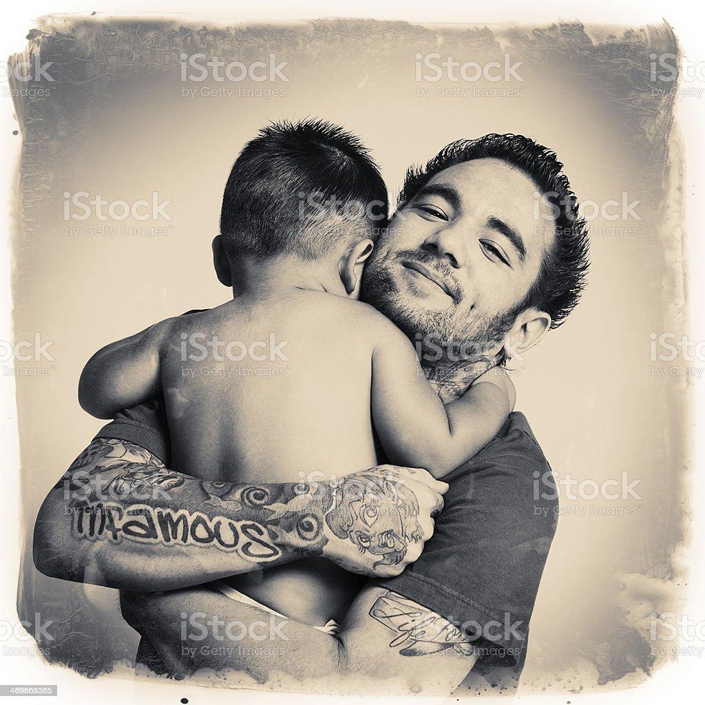tattooed daddy hug stock photo