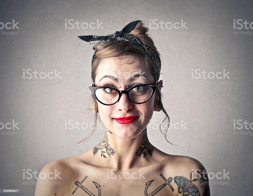 Tattooed girl stock photo