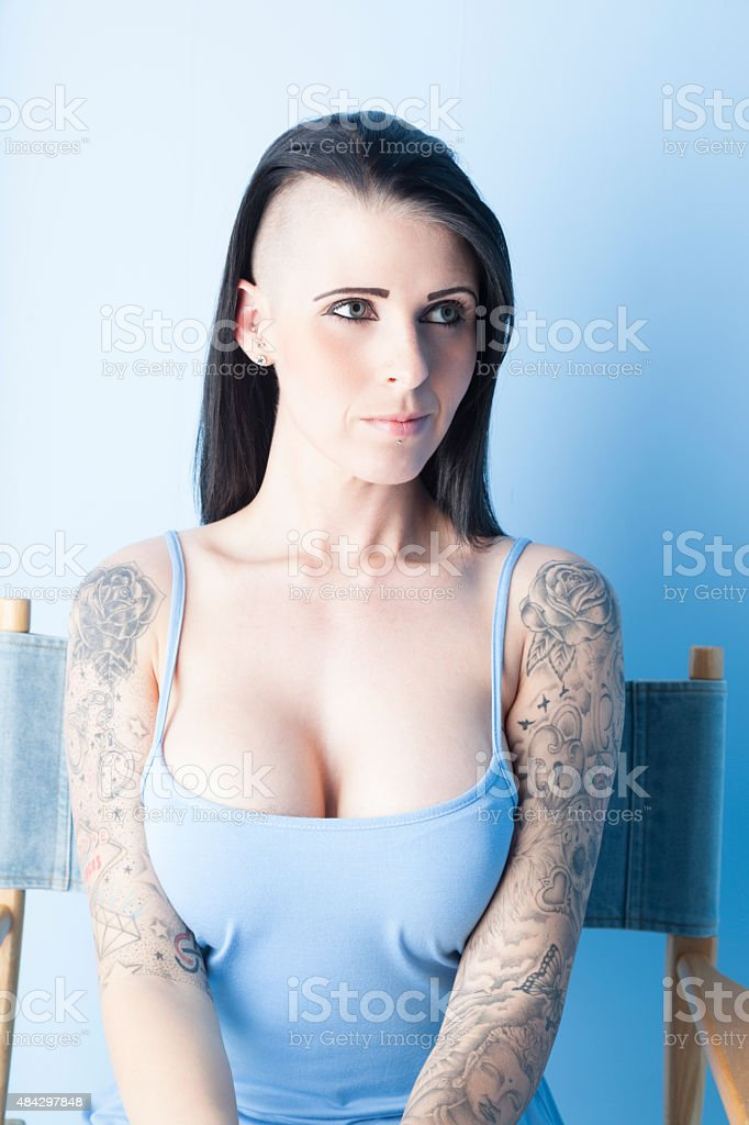 Tattooed Girl Wearing A Pastel Blue Dress stock photo