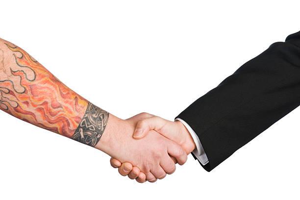 Tattooed Handshake stock photo