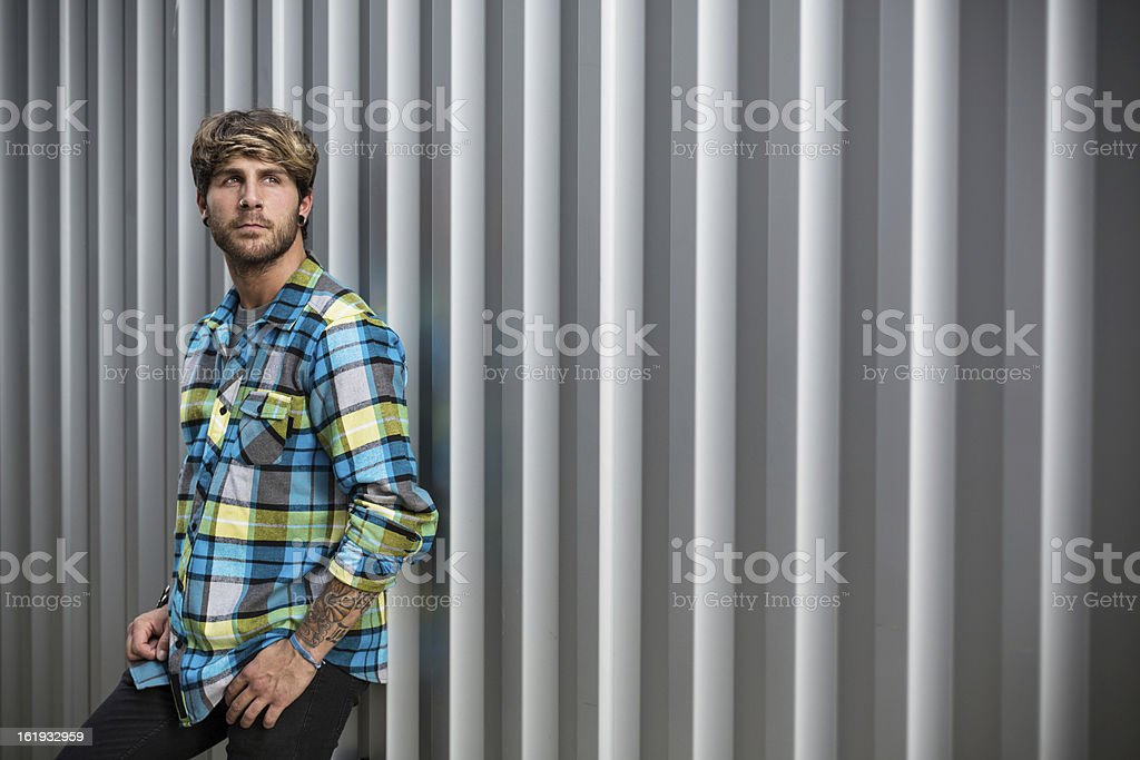 Tattooed male model with shirt and jeans. royalty-free stock photo