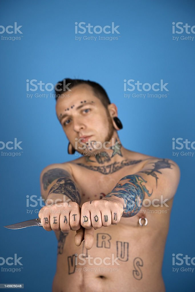 Tattooed man holding knife. royalty-free stock photo