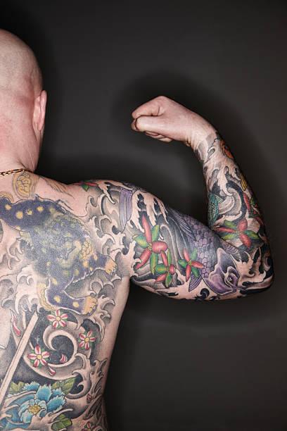 tattooed mann - tribal tattoos stock-fotos und bilder