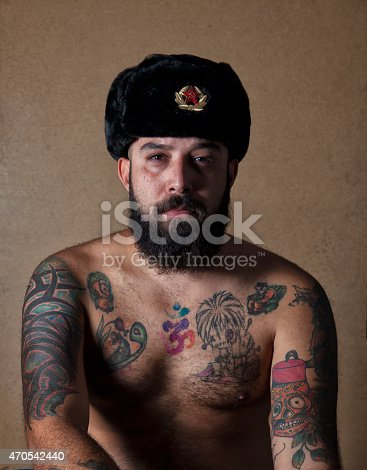 istock Tattooed Man Wearing Soviet Fur Hat 470542440