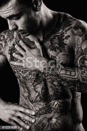 1134770826 istock photo Tattooed Muscular Male Shirtless and Emotional 610257638