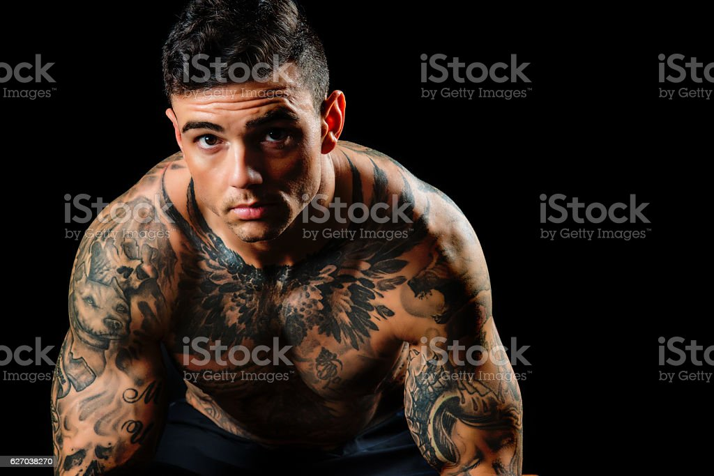 Tattooed Muscular Male Shirtless and Serious stock photo