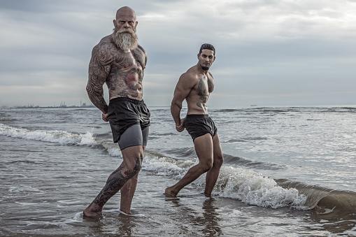 istock Tattooed Senior Man coaching young man During Workout 1024123888