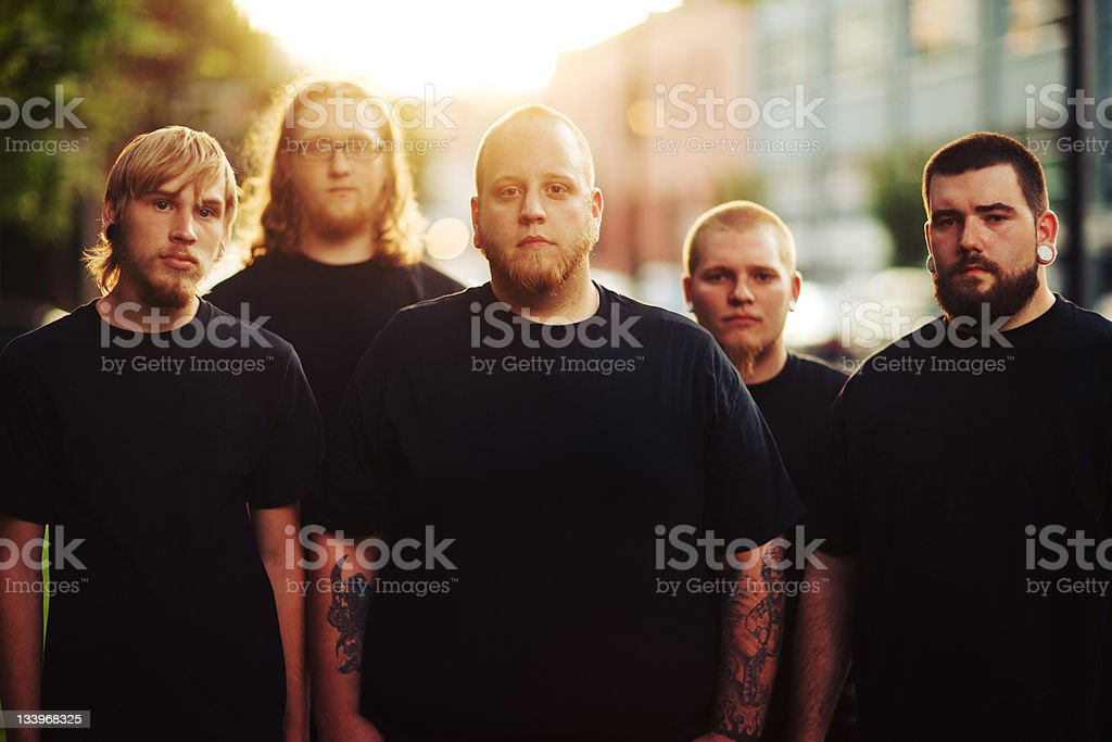 Tattooed Sunset Urban Men Group royalty-free stock photo
