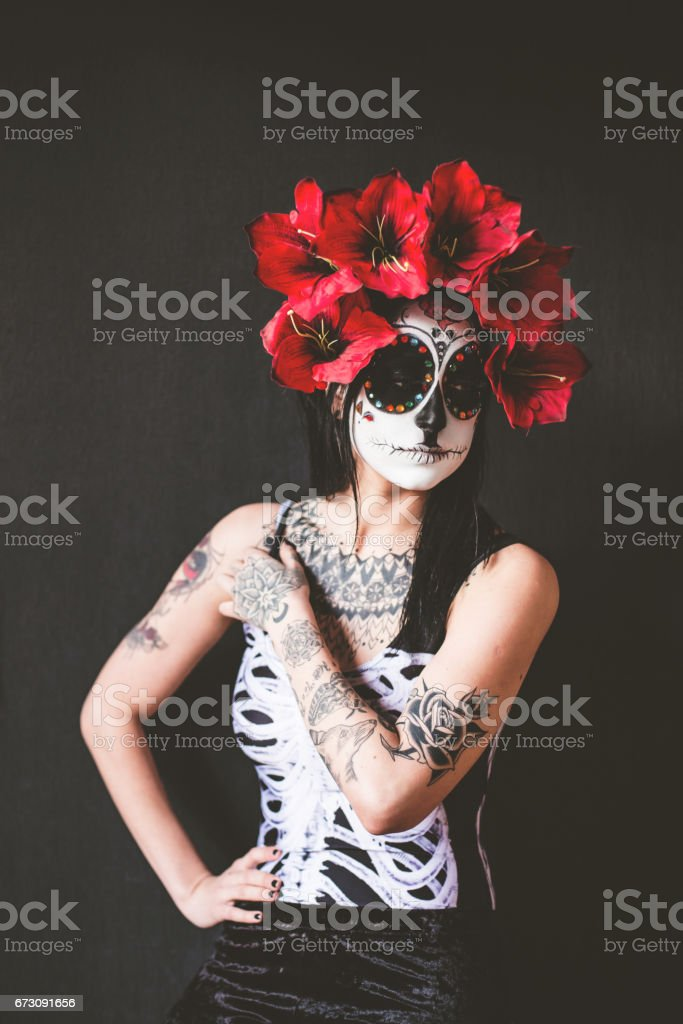Tattooed woman celebrating Day of the dead stock photo