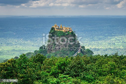 Aerial view to Taung Kalat Buddhist Monastery on Top of Volcanic Plug, which rises 657m (2156 ft) above the sea level. Steep wooden stairway going up to Taung Kalat (Pedestal Hill), Buddhist Pilgrimage Site, Mount Popa National Park, Bagan - Mandalay, Burma, Myanmar, Asia
