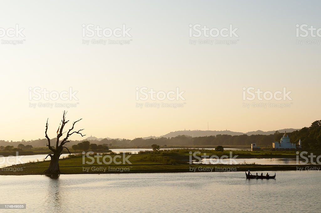 Sunset over lake in Amarapura, Myanmar royalty-free stock photo