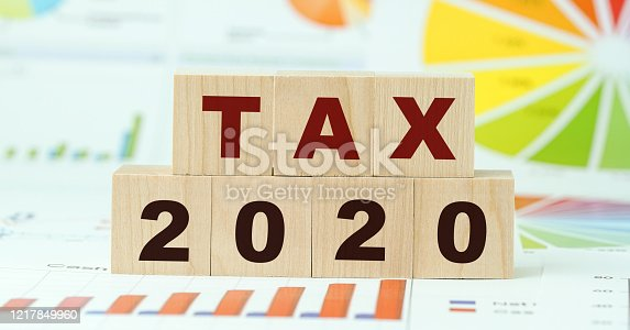 1170746979 istock photo tax 2020 text in letters on wooden blocks 1217849960