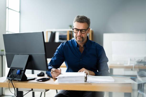 Tax Accountant Advisor Man Doing Accounting stock photo