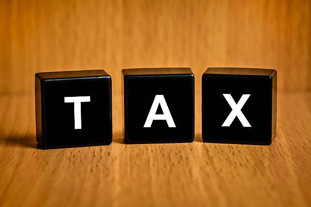 Tax accounting text on block stock photo