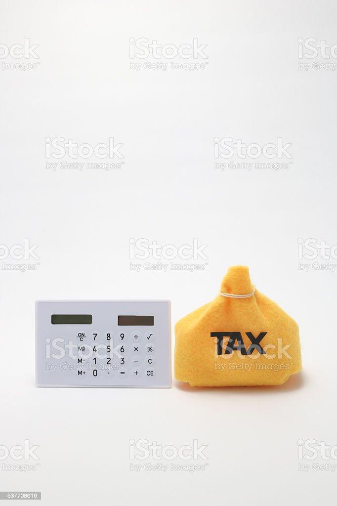 Tax and calculator. stock photo