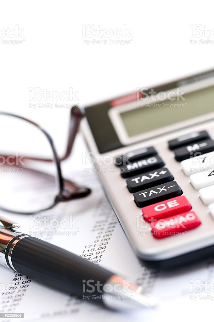 Tax calculator pen and glasses royalty-free stock photo