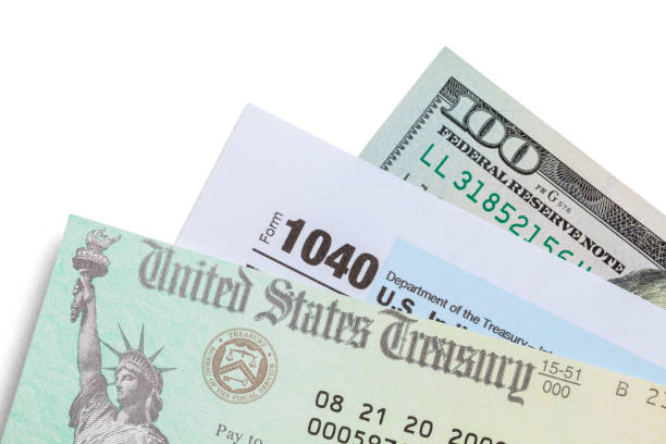 Tax Check With 1040 and Cash Tax Refund Check with Form 1040 and One Hundred Dollar Bill. stimulus check stock pictures, royalty-free photos & images