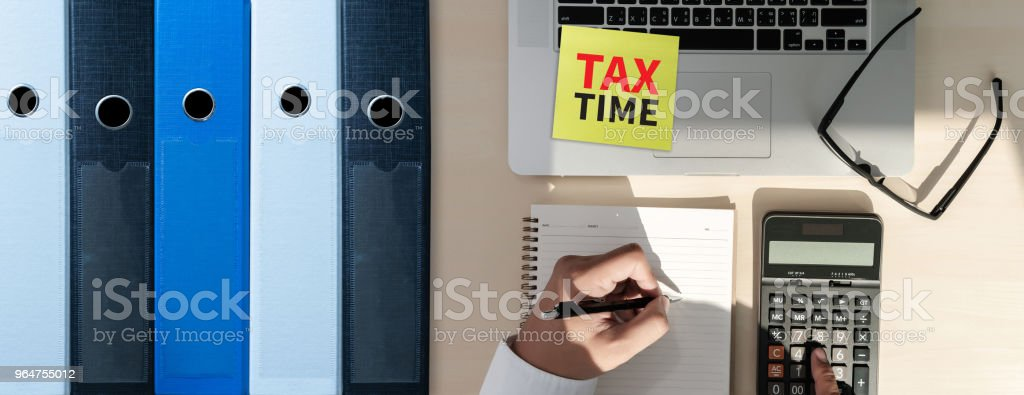Tax Concept Business analyzing Individual income tax return form royalty-free stock photo