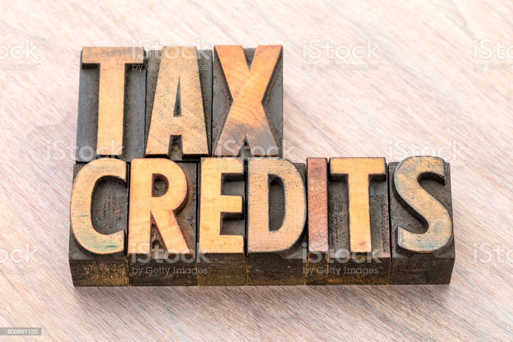 tax credits word abstract in wood type stock photo