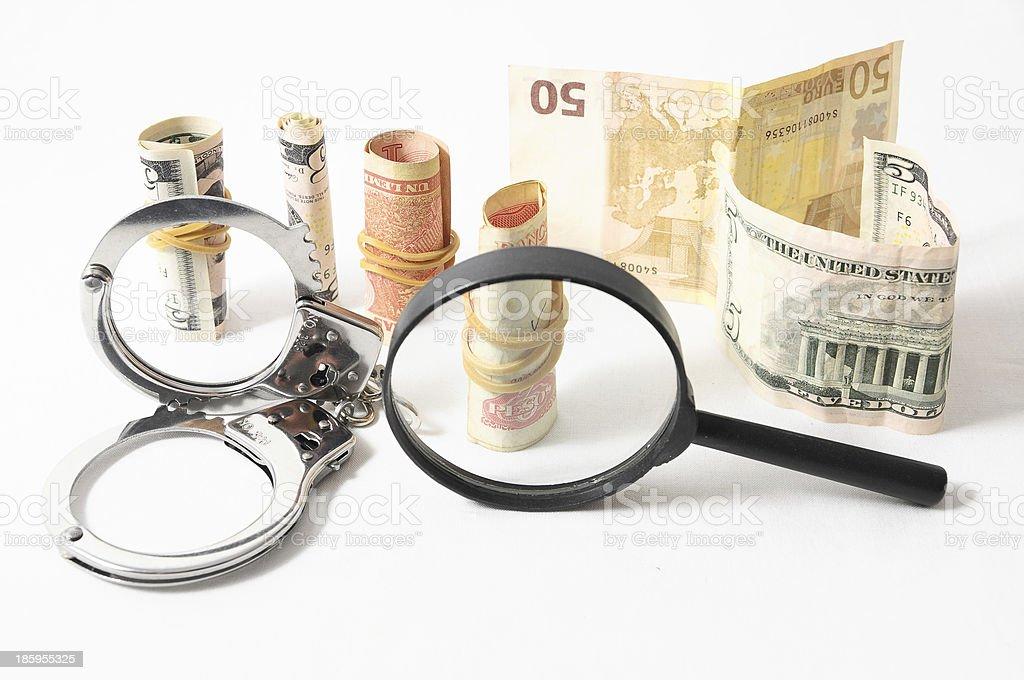 Tax Crime Concept Money and Handcuff stock photo